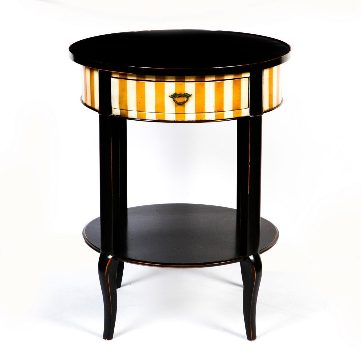 A round end table with dark finish and white and gold vertical stripes.