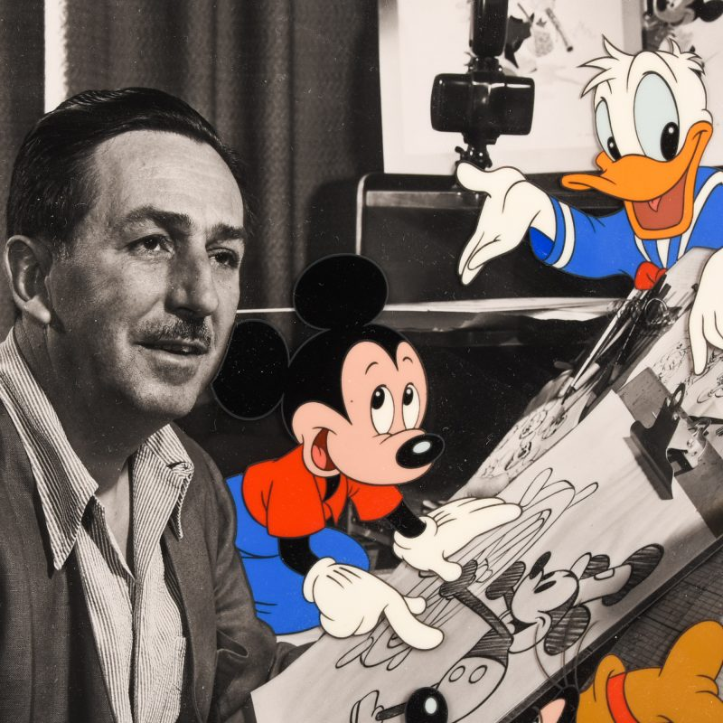 Walt Disney with Mickey Mouse and Daffy Duck